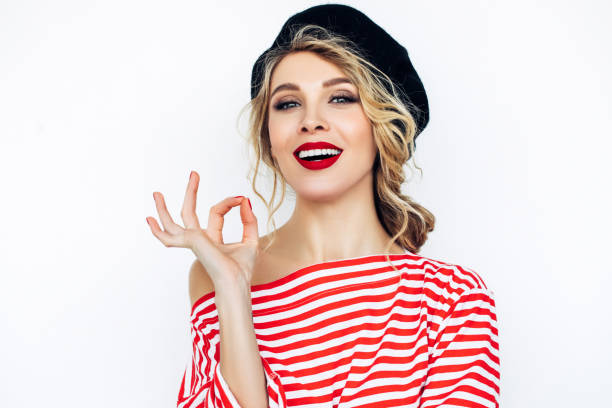 Beautiful blonde french woman wearing red beret stock photo