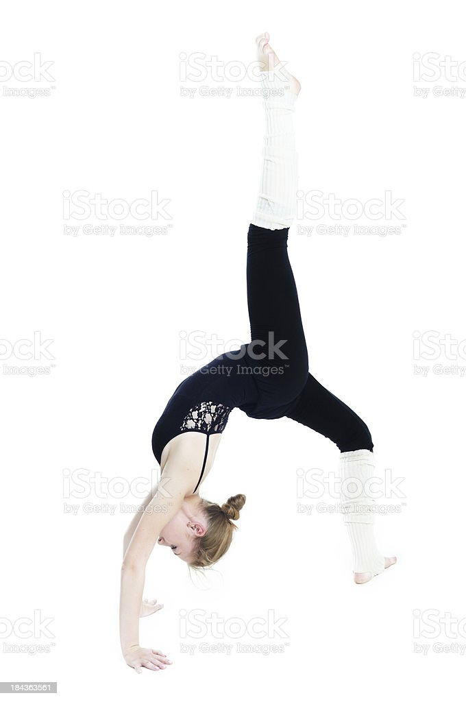 Beautiful blonde girl doing gymnastic exercise royalty-free stock photo