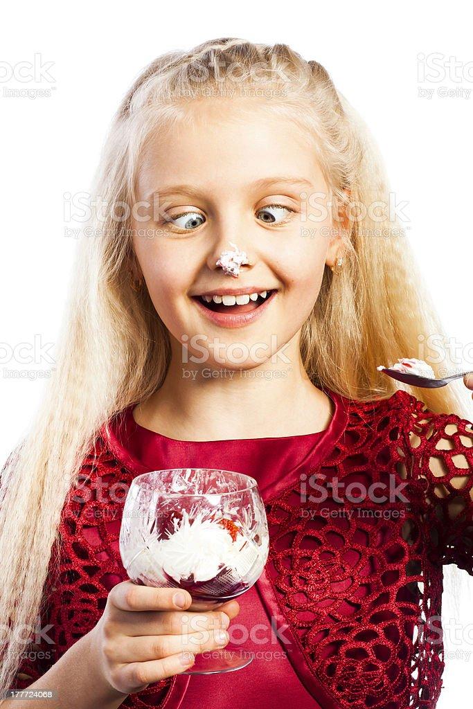Beautiful blonde girl eating dessert royalty-free stock photo