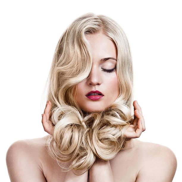 Beautiful Blonde Girl. Healthy Long Curly Hair. stock photo