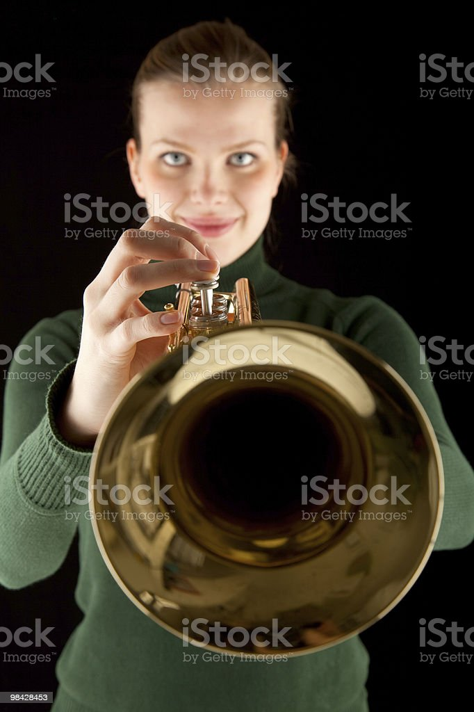 beautiful blonde girl holds a golden trumpet royalty-free stock photo