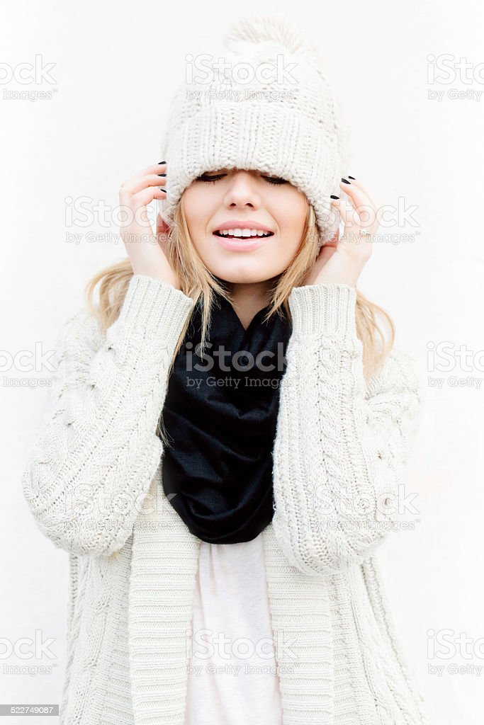 Beautiful blonde girl in knitted clothes stock photo