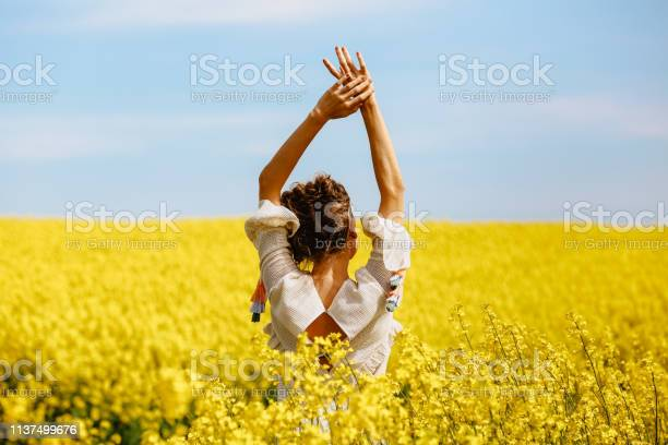 Photo of Beautiful blonde girl posing in yellow field