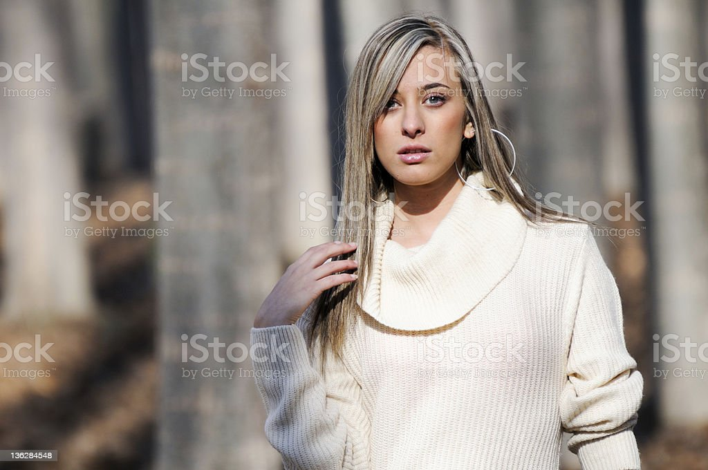 Beautiful blonde girl standing in a poplar forest royalty-free stock photo
