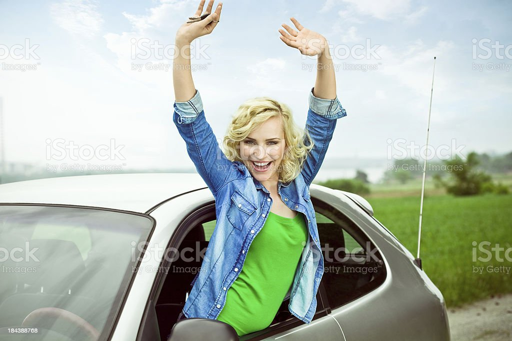 Beautiful Blonde in her car stock photo