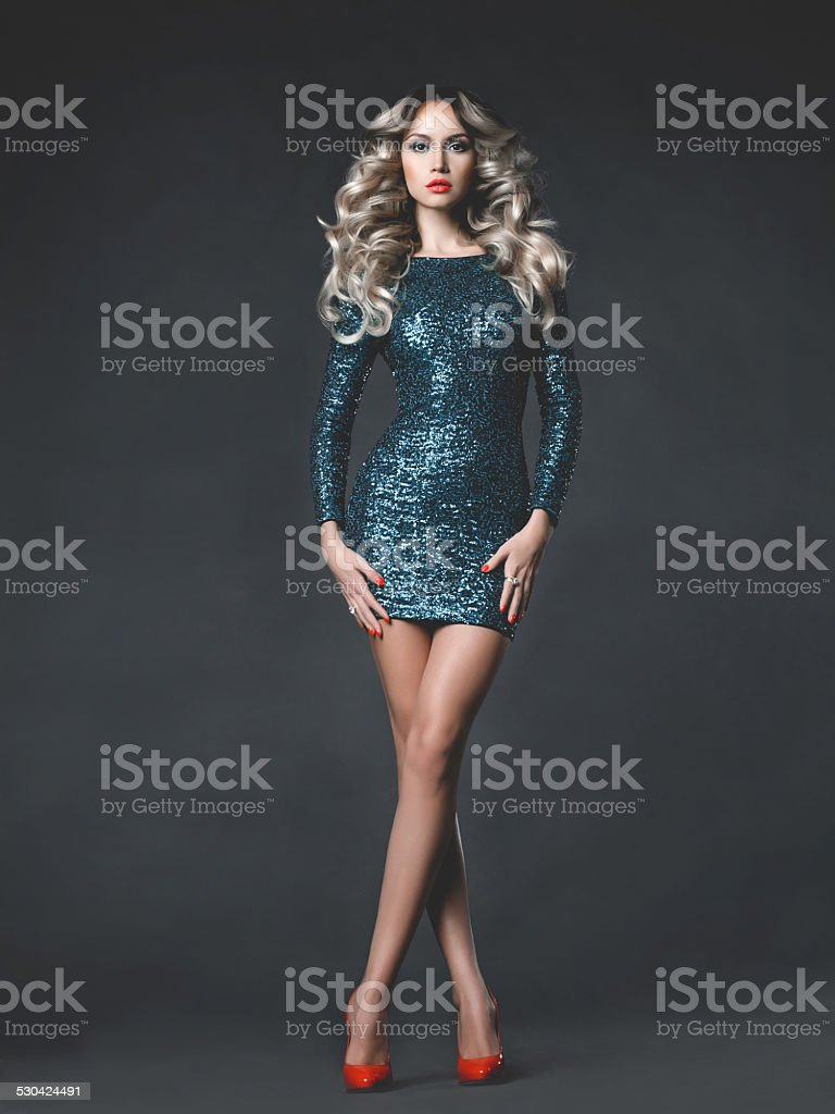 Beautiful blonde in sequined dress stock photo