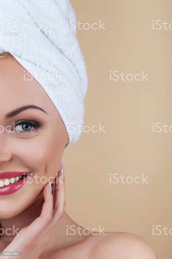 Beautiful blonde isolated on brown background royalty-free stock photo