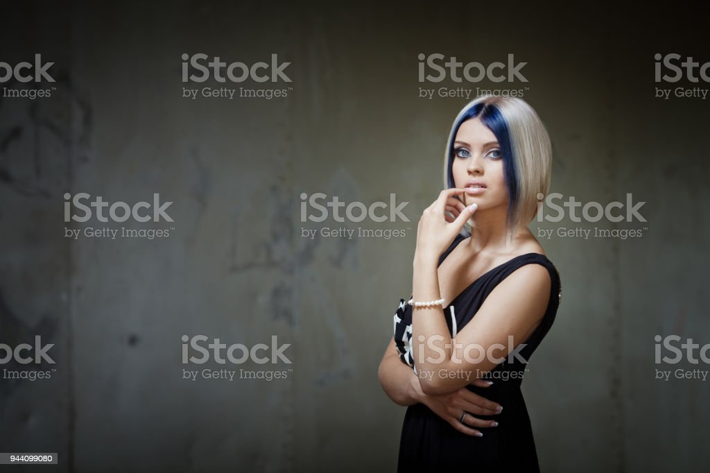 Beautiful blonde model with futuristic haircut stock photo