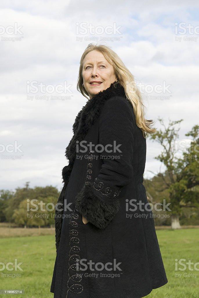 Beautiful blonde older woman stock photo