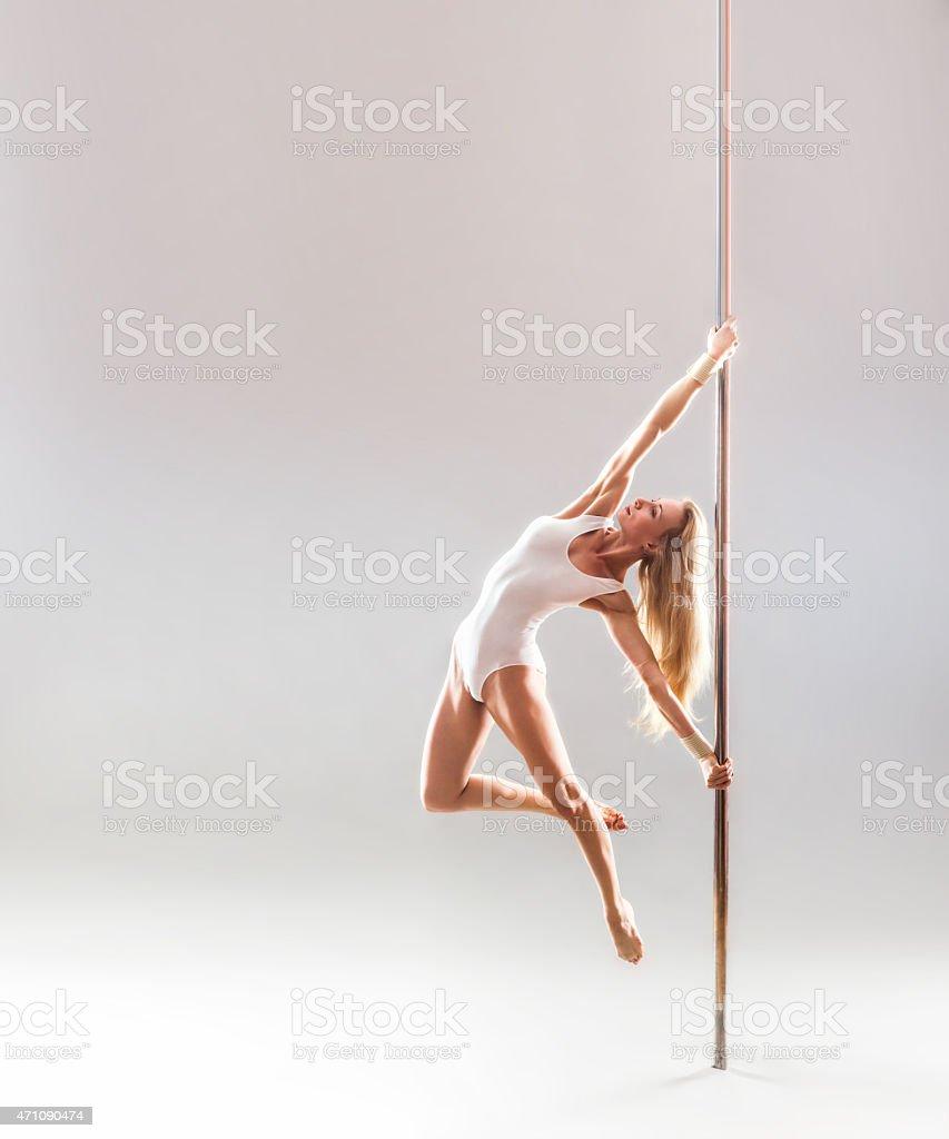 Beautiful blonde sexy pole dance woman stock photo