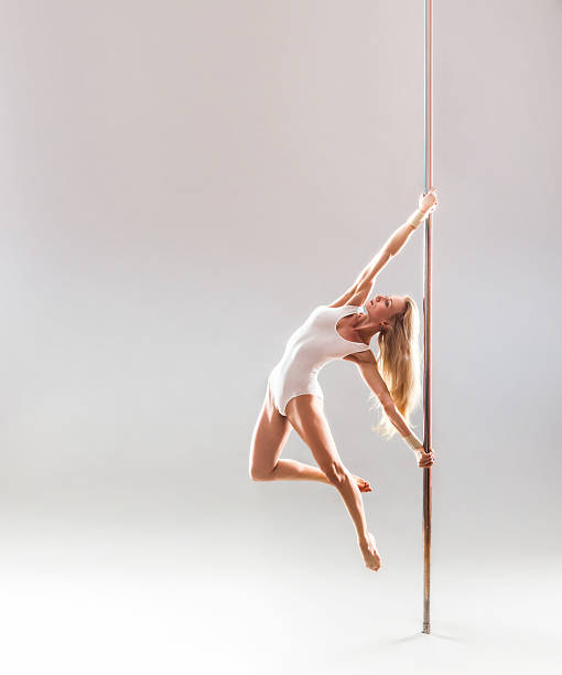 Beautiful blonde sexy pole dance woman stock photo