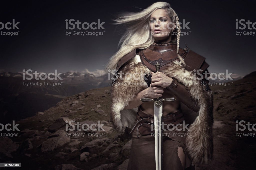 Beautiful Blonde Sword wielding viking warrior female stock photo