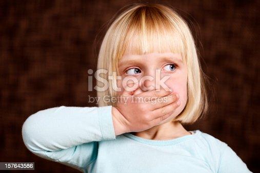 istock Beautiful blonde toddler makes 'Speak no Evil' sign 157643586