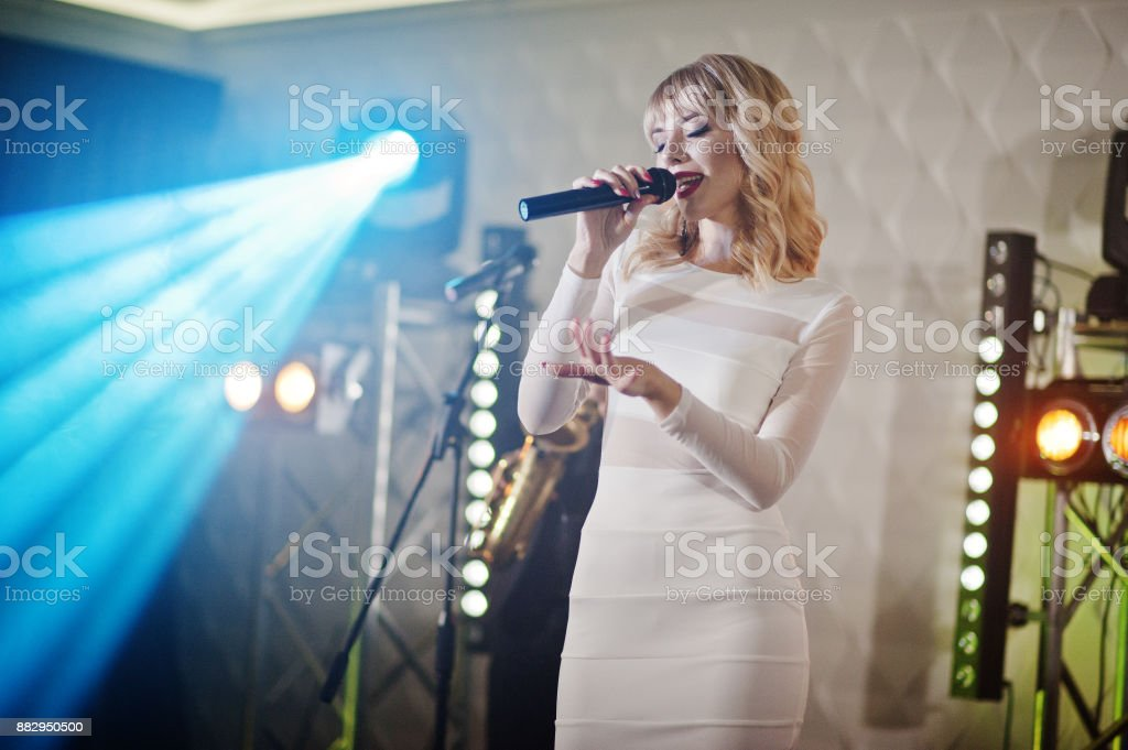 Beautiful blonde vocal singer girl on stage.