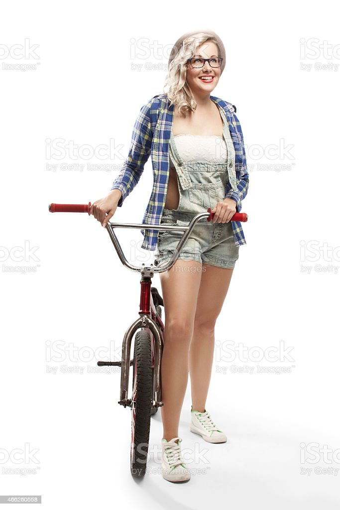 Beautiful blonde with a BMX bike stock photo
