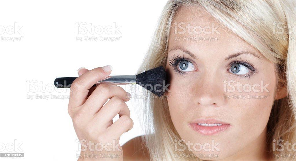 beautiful blonde woman applying Make-up royalty-free stock photo