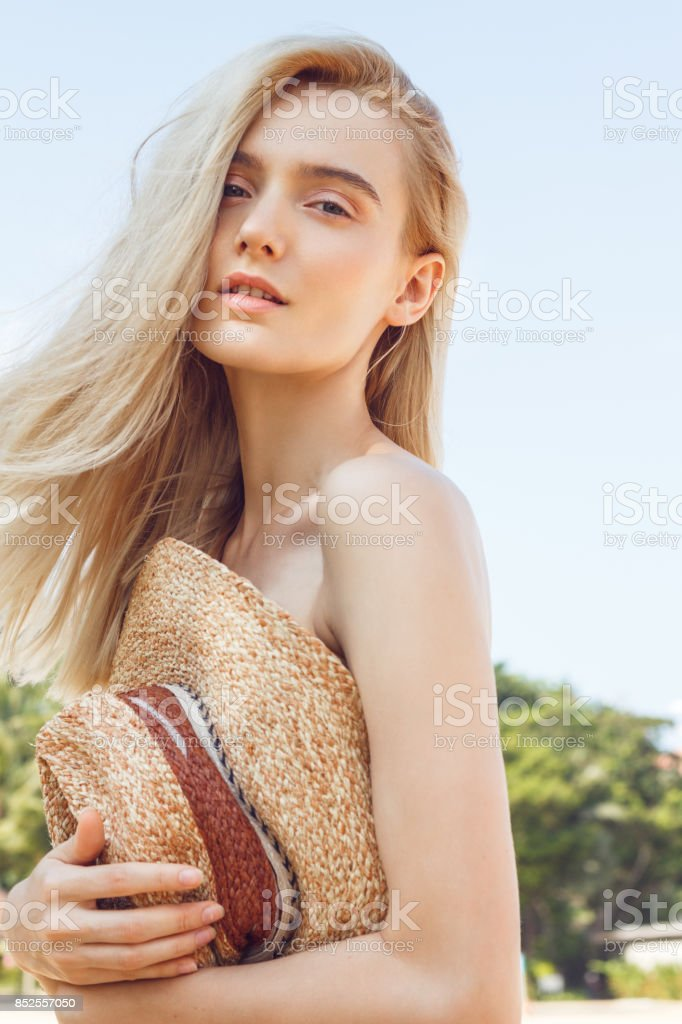 beautiful-blonde-woman-covered-with-a-ha