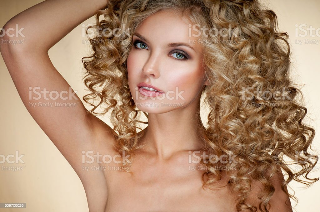 Beautiful blonde woman. Healthy Long Blond Hair. Curly Hair. stock photo