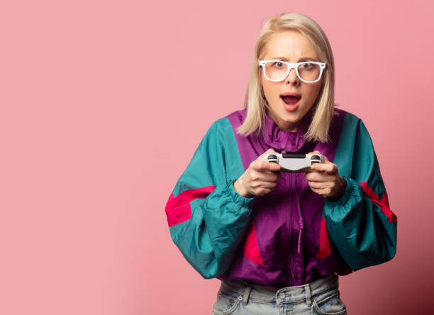 Beautiful blonde woman in 90s clothes with joystick stock photo