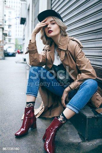 istock Beautiful blonde woman in a coat 867235160