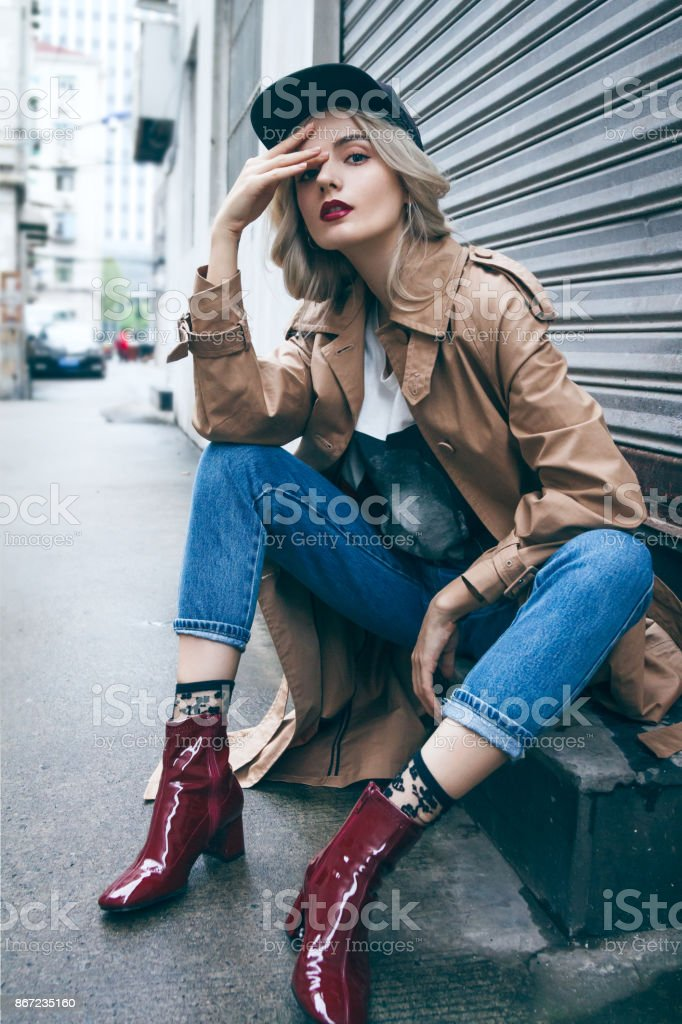 Beautiful blonde woman in a coat stock photo
