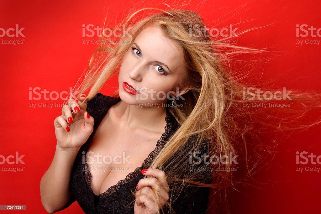 beautiful blonde  woman in black dress with ajar breast stock photo