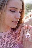 Beautiful woman in pink dress and ladybug insect