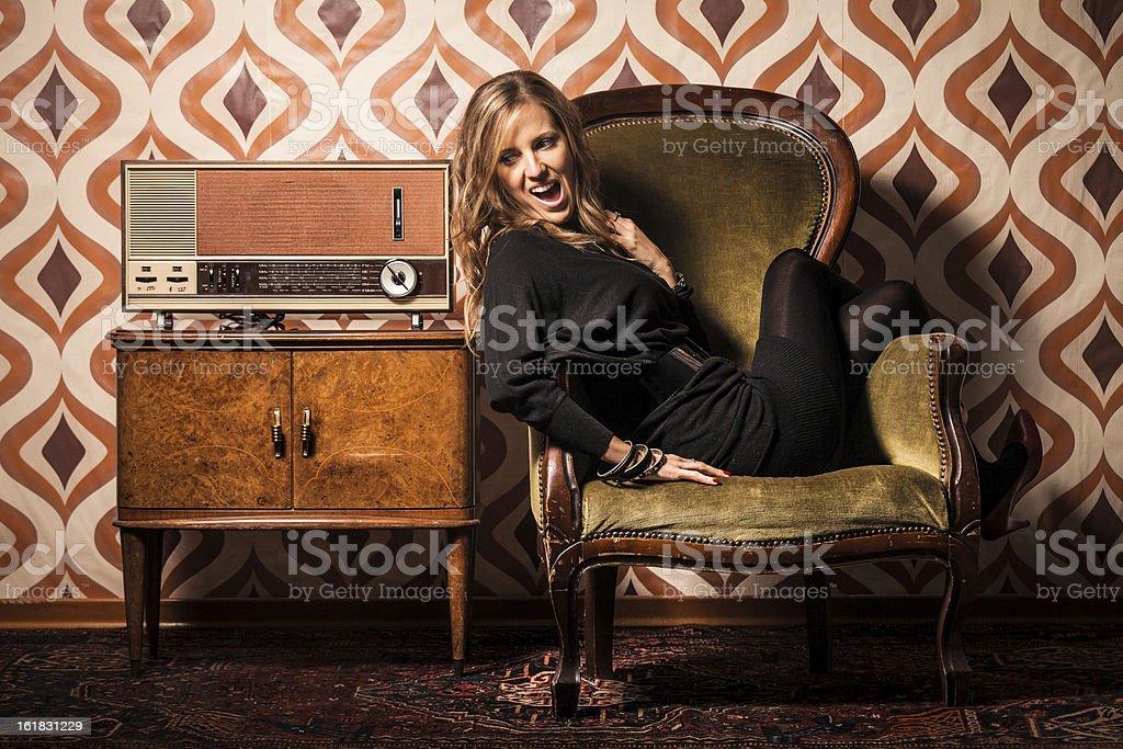 Beautiful Blonde Woman Listening Amazing News on Vintage Radio stock photo