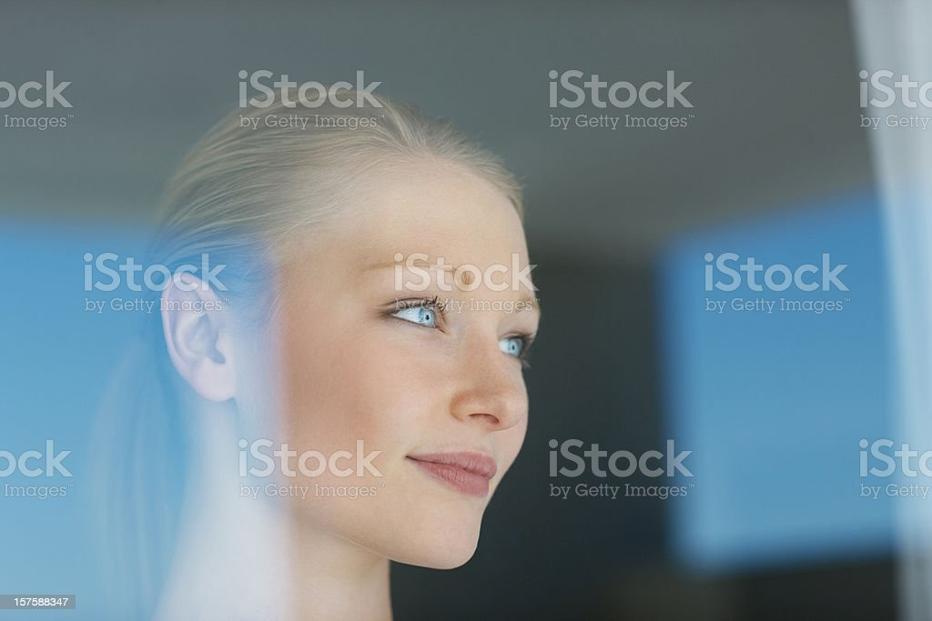 Beautiful Blonde Woman Looking Out Window royalty-free stock photo