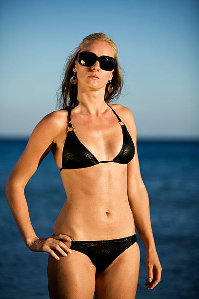 Beautiful blonde woman Beautiful blonde woman posing with bikinis middle aged women in bikinis stock pictures, royalty-free photos & images
