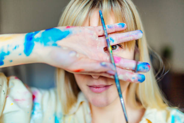 Beautiful blonde woman playing with colors stock photo