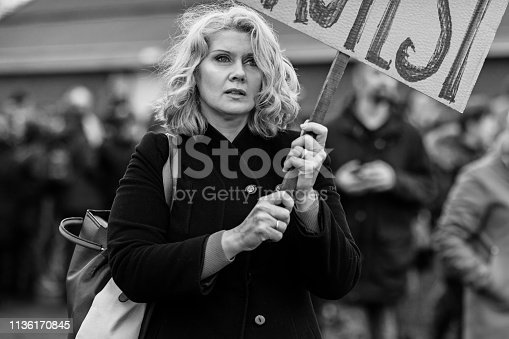 Beautiful blonde middle aged woman at an outdoor protest