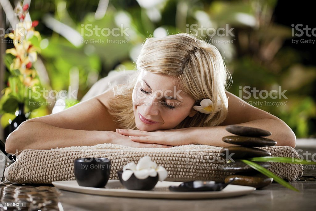 Beautiful blonde woman relaxing at the spa. royalty-free stock photo