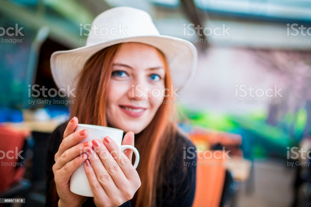 Beautiful blonde woman sitting in the head stock photo