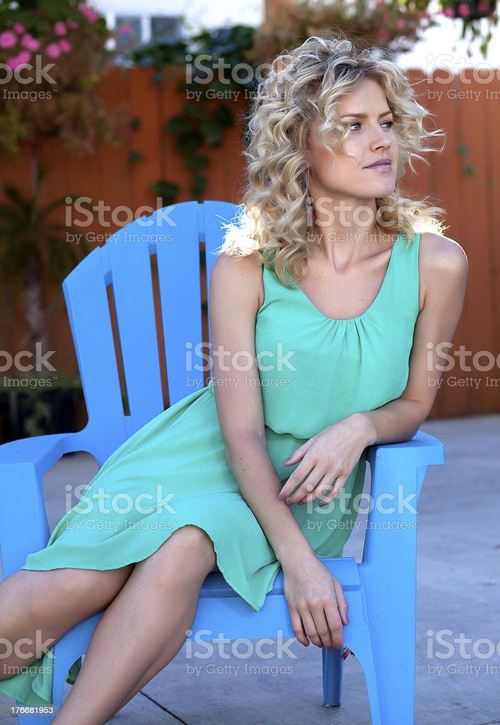 Beautiful Blonde woman sitting outside royalty-free stock photo