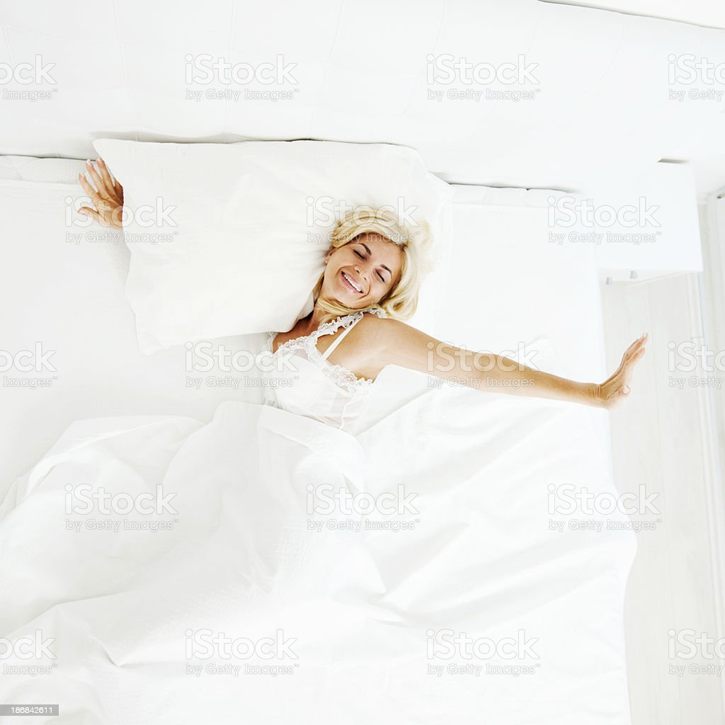 Beautiful blonde woman waking up. royalty-free stock photo