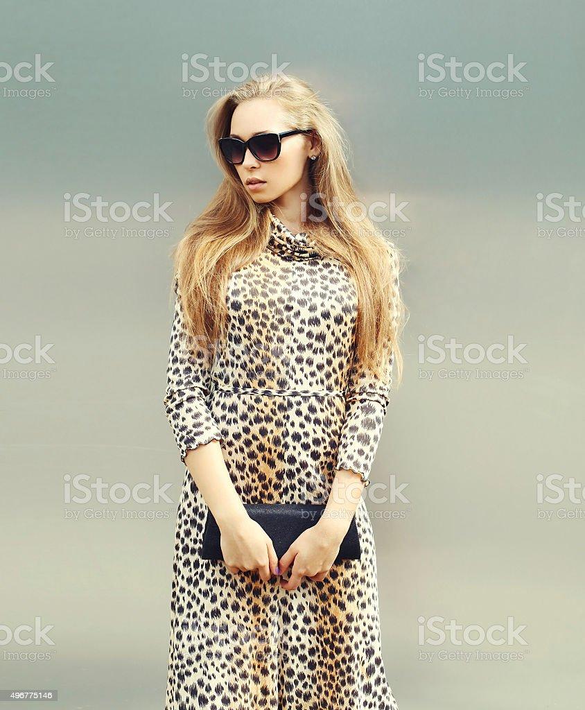 beautiful blonde woman wearing a leopard dress and sunglasses wi stock photo