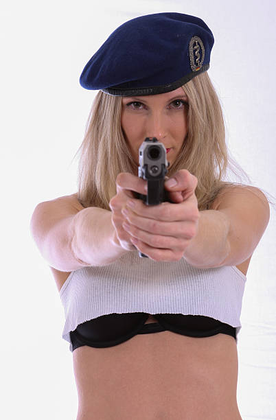 Beautiful Blonde Woman With A Pistol stock photo