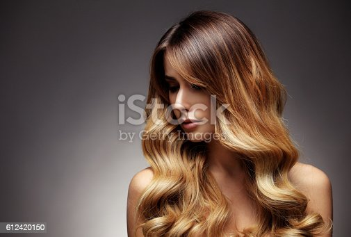 istock Beautiful blonde woman with long, healthy , straight and shiny hair. 612420150