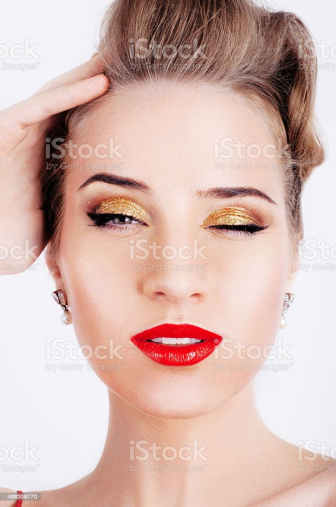 Beautiful blonde woman with red lips and golden makeup royalty-free stock photo