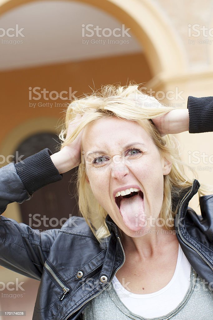Beautiful blonde woman with tongue out stock photo