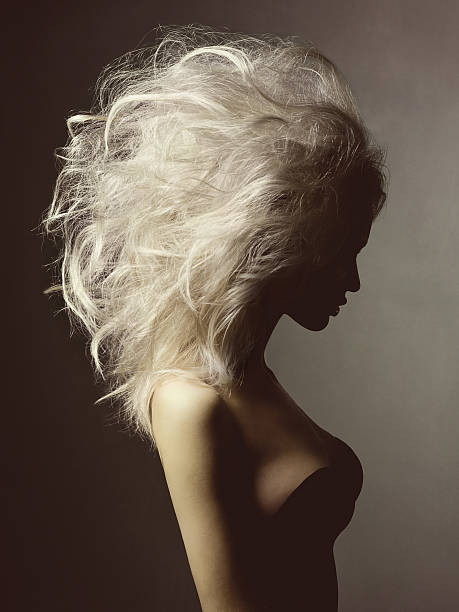 Beautiful blonde woman with volume hairstyle stock photo