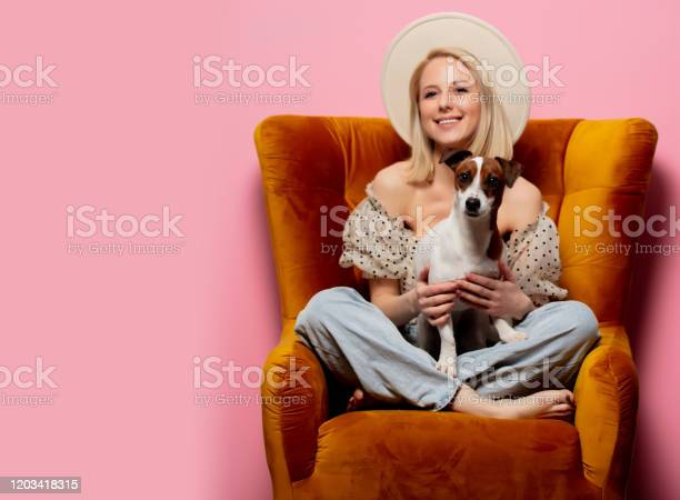 Beautiful blonde womanwith a dog in an armchair on pink background picture id1203418315?b=1&k=6&m=1203418315&s=612x612&h=ypxnbijyj zu8btatmubhy6tpxdacd3pploigdmalhk=