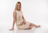 istock Beautiful blonde women sittin on white background 1187625769