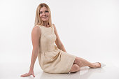 istock Beautiful blonde women sittin on white background 944286116