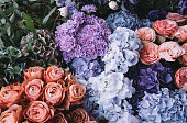 istock Beautiful blossoming flowers (roses, hydrangeas, carnations, eustoma) in blu, antique blue and peach colours at the florist shop 1131373310