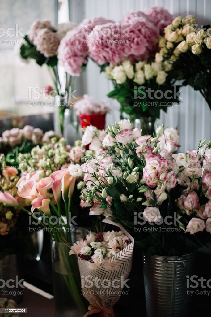 Beautiful blossoming fresh flowers at the florist shop: roses,...