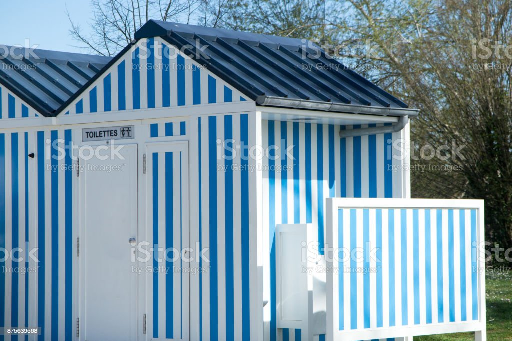 beautiful blue and white cabin that serves as a toilet in the park stock photo