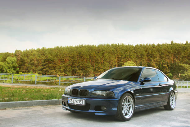 Beautiful blue BMW E46 sports car in the countryside stock photo
