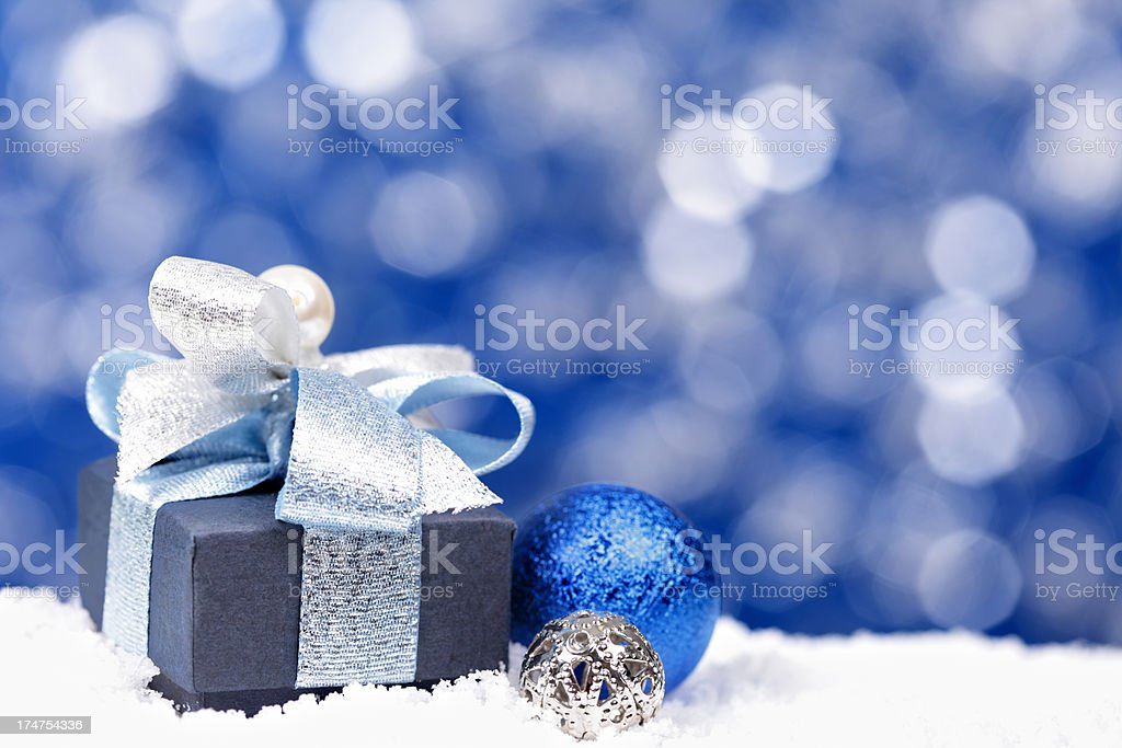Beautiful blue Christmas background with copy space and gift stock photo